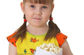 Little girl keeps package with popcorn — Stock Photo