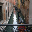 Gondolas on the Venetian channels - Stock Photo