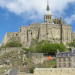 The rocky tidal island Mont-Saint-Michel - Stock Photo