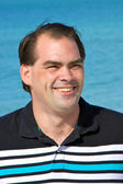 Average dark haired man smiling — Stock Photo