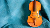 Violin body againt blue — Stock Photo