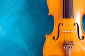 Waist of violin against blue — Stock Photo