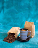 Coffee on mottled blue — Stock Photo