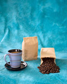 Cup of coffee with bags — Stock Photo