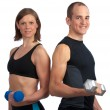 Young couple with dumbells - Stock Photo