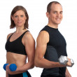 Stock Photo: Young couple with dumbells