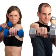 Stock Photo: Couple with dumbells and attitude