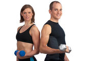 Young couple with dumbells — Stock Photo