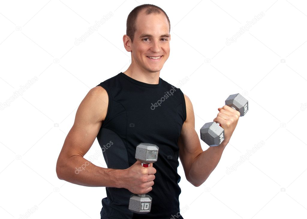 Young, caucasian man working out with dumbells, smiling at camera  Stock Photo #3044885