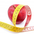 Royalty-Free Stock Photo: Apple and measuring tape on white