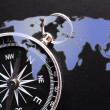 Royalty-Free Stock Photo: Compass and world map