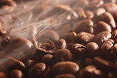 Coffee beans with steam — Stock Photo