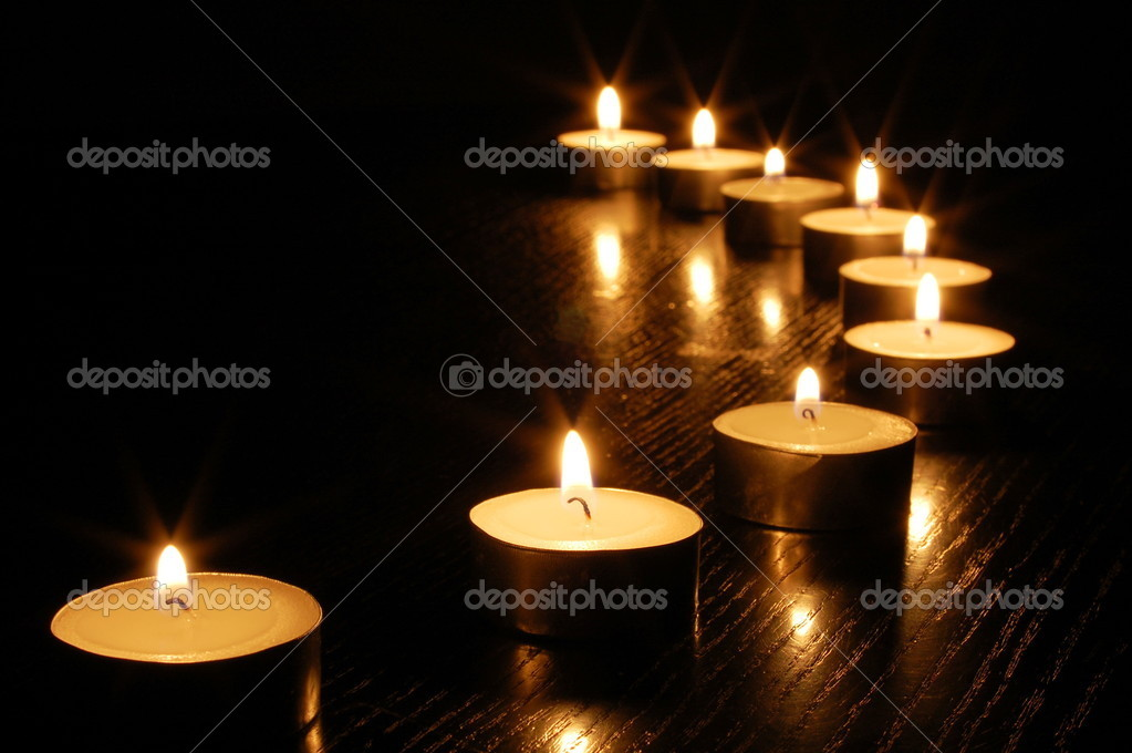 Romantic candle light on a black background — Stock Photo #2988137