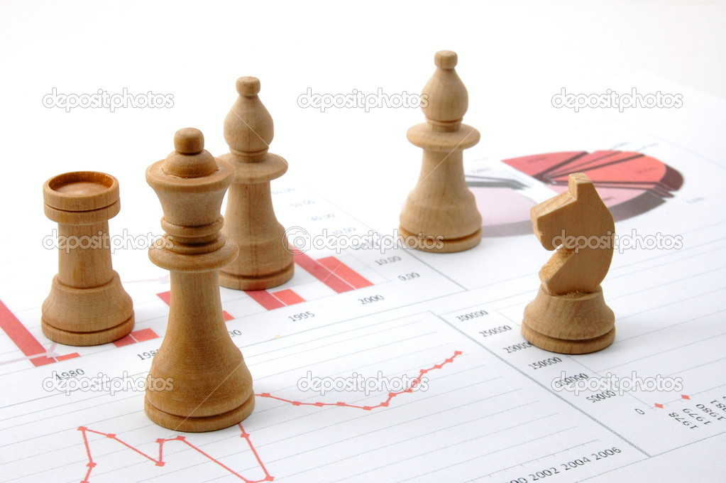 Chess man over business chart admonish to strategic behavior  Stock Photo #2988244