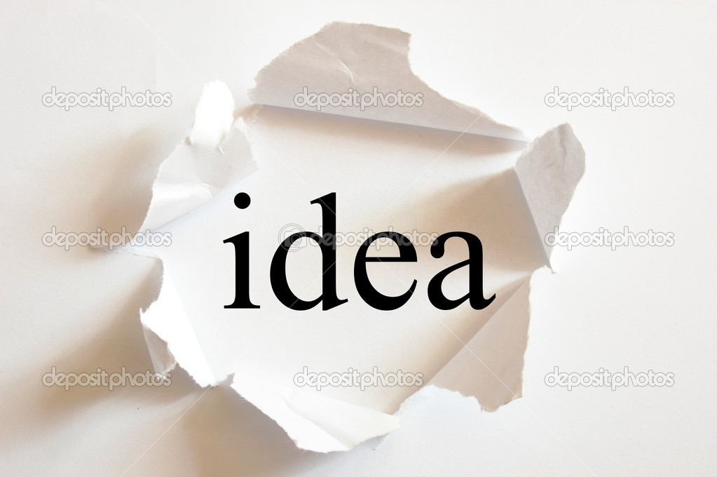Idea on white background in a paper hole — Stock Photo #2989768