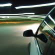 Night drive with car in motion — Stock Photo