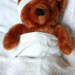 Sick teddy with injury in bed — Stock Photo #2994033