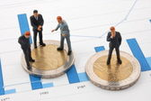 Businessman and money over a chart — Stock Photo