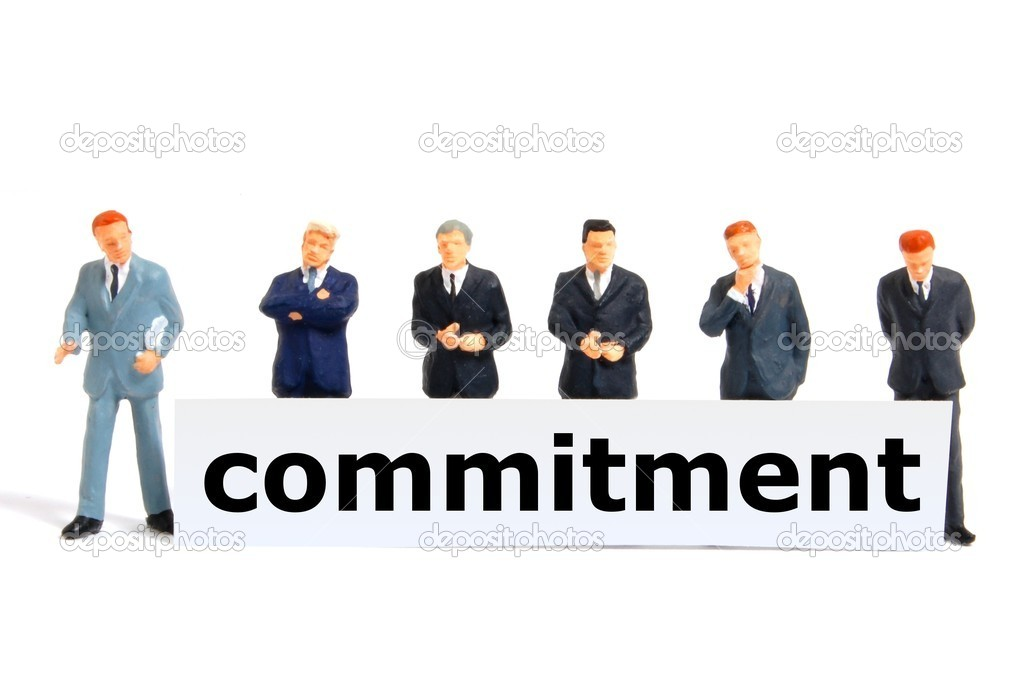 Business commitment with small toy man isolated on white background — Stock Photo #2994281