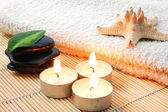 Foldet white bath towel and zen stones — Stock Photo
