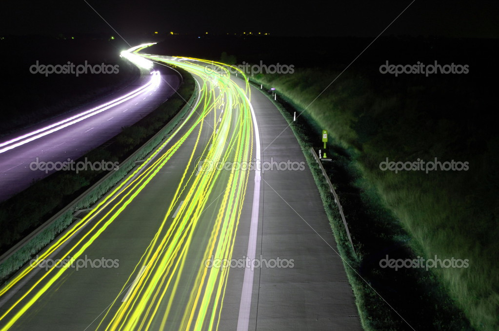 Road with car traffic at night and blurry lights showing speed and motion  Stok fotoraf #3022329
