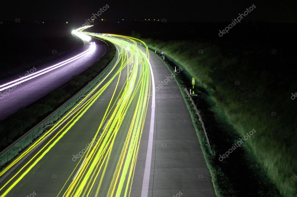 Road with car traffic at night and blurry lights showing speed and motion — ストック写真 #3022329