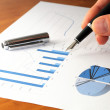 Business chart and hand — Stock Photo