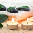 Foldet white bath towel and zen stones - Stock Photo