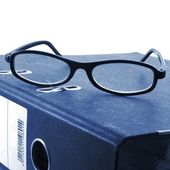Eye glasses and folder — Stock Photo