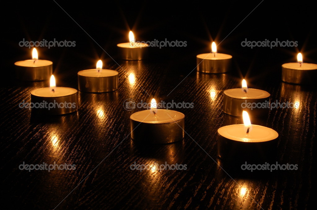 Romantic candle light on a black background  Stock Photo #3062933