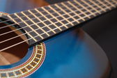 Blue music guitar for playing party music — Stock Photo