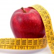 Apple and measuring tape on white — Foto de Stock