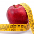 Apple and measuring tape on white - Stock Photo