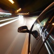 Night drive with car in motion - Stock Photo