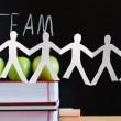 Teamwork and chalkboard — Stock Photo