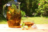 Cup of tea in the garden — Stock Photo
