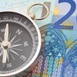 Euro money and compass — Stock Photo #3483569