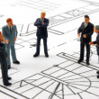 Stock Photo: Meeting of businessmon architecture plan