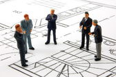 Meeting of businessman on architecture plan — Stock Photo