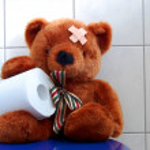 Toy teddy bear on wc toilet — Stock Photo