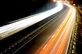 Road with car traffic at night with blurry lights — Stock Photo