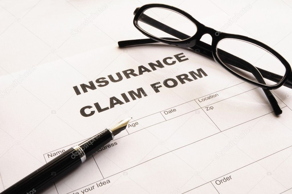 Insurance claim for on desk in office showing risk concept — Stock Photo #3563949