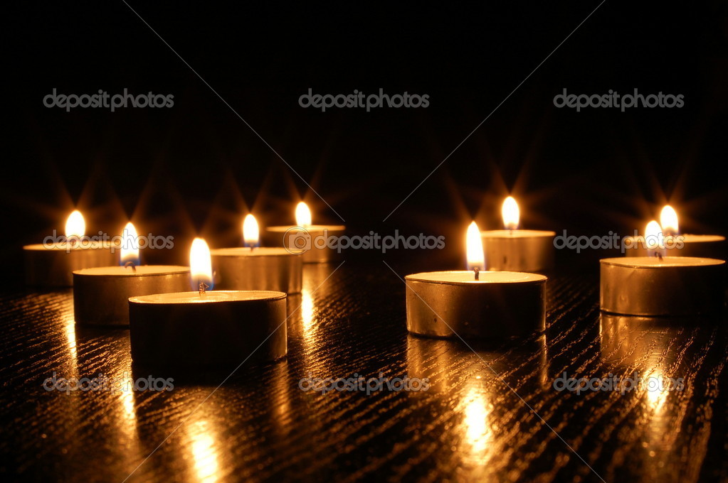 Romantic candle light on a black background — Stock Photo #3634295