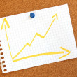 Business graph with arrow showing growth - Stock Photo