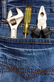 Tools and jeans — Stock Photo