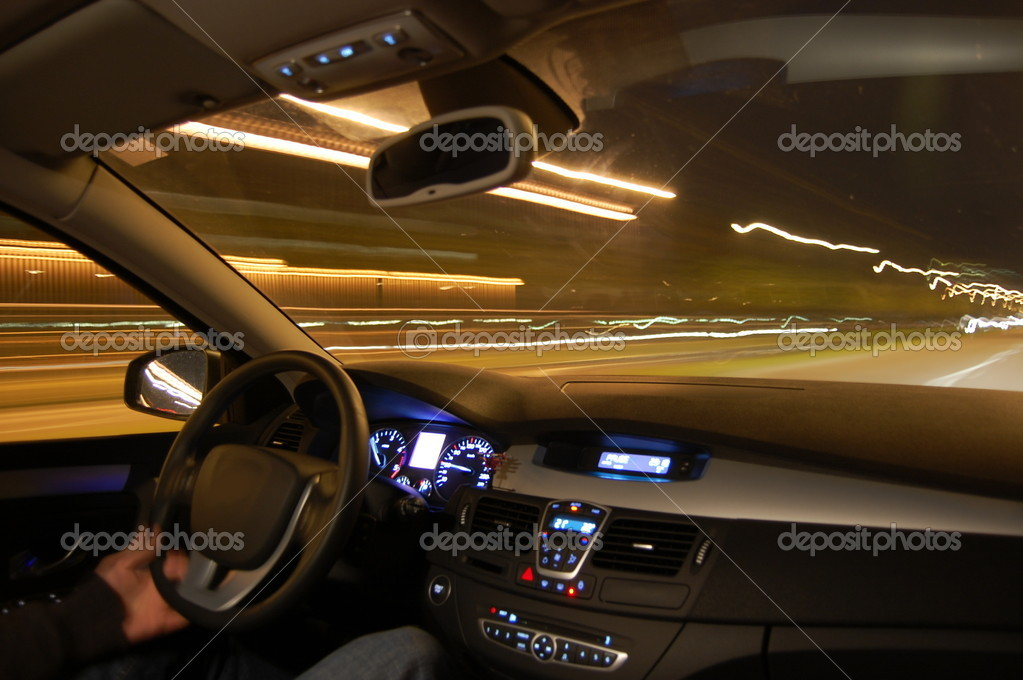 Speed car at night in motion with traffic — Stock Photo #3683407