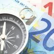 Euro peníze a kompas — Stock fotografie
