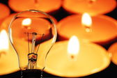 Bulb and candle — Stock Photo