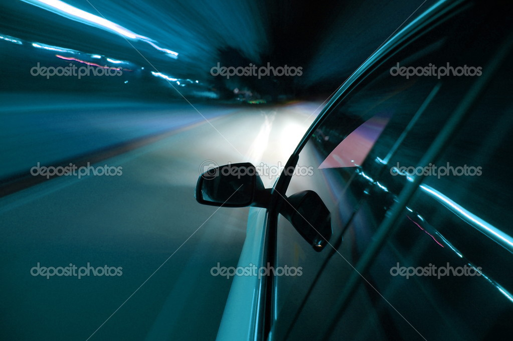 Night drive with car in motion through the city shows the speed — Stock Photo #3703505