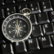 Stock Photo: Computer keyboard and compass